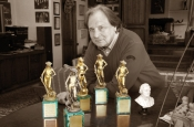 "Riz Ortolani in his study with the five ""David of Donatello"" awards"