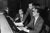 "Franco Prosperi, Gualtiero Jacopetti and Riz Ortolani at the console during the recording of the music for the movie ""Mondo Cane"" in Rome"